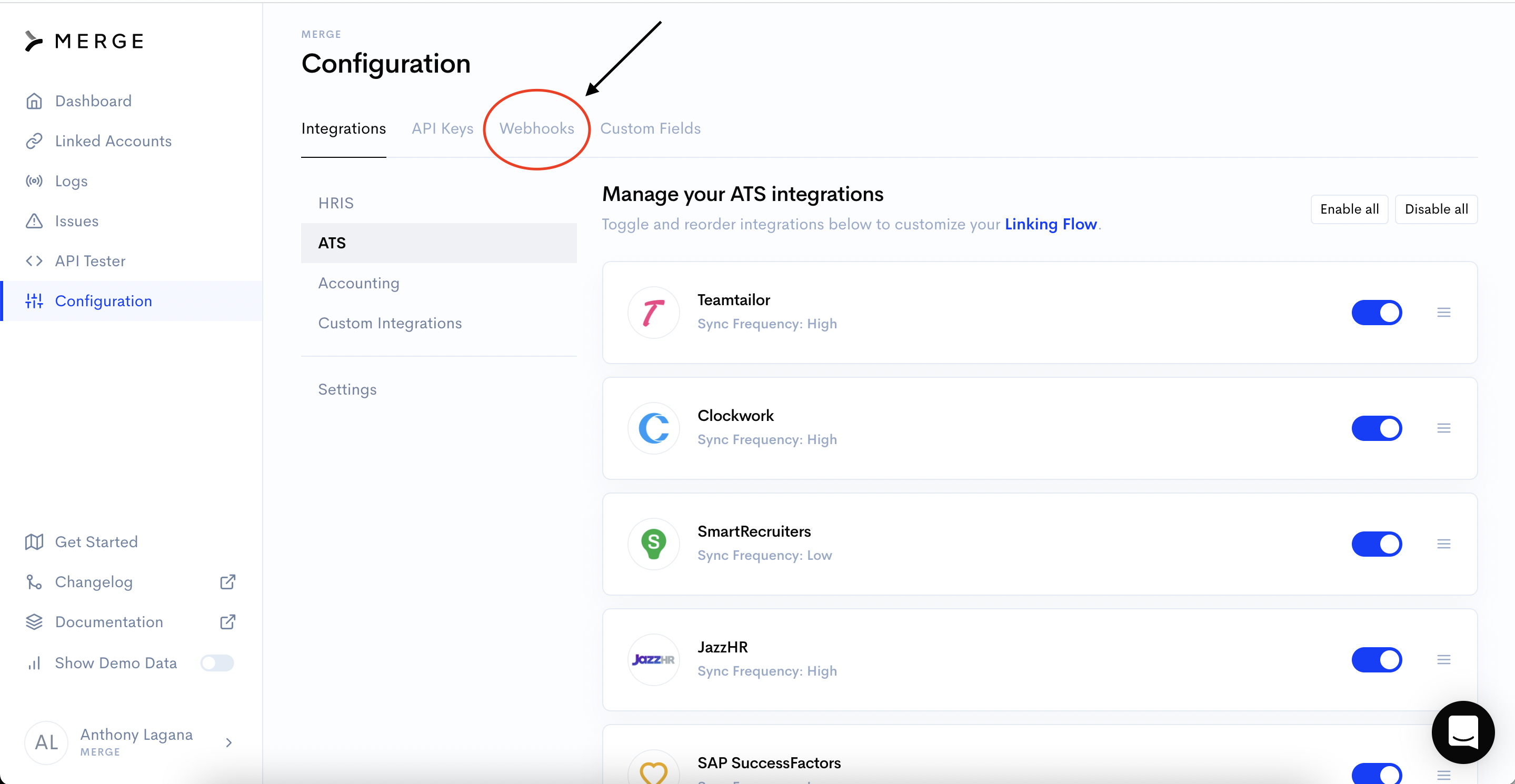 Merge dashboard showing arrow pointing to Webhooks